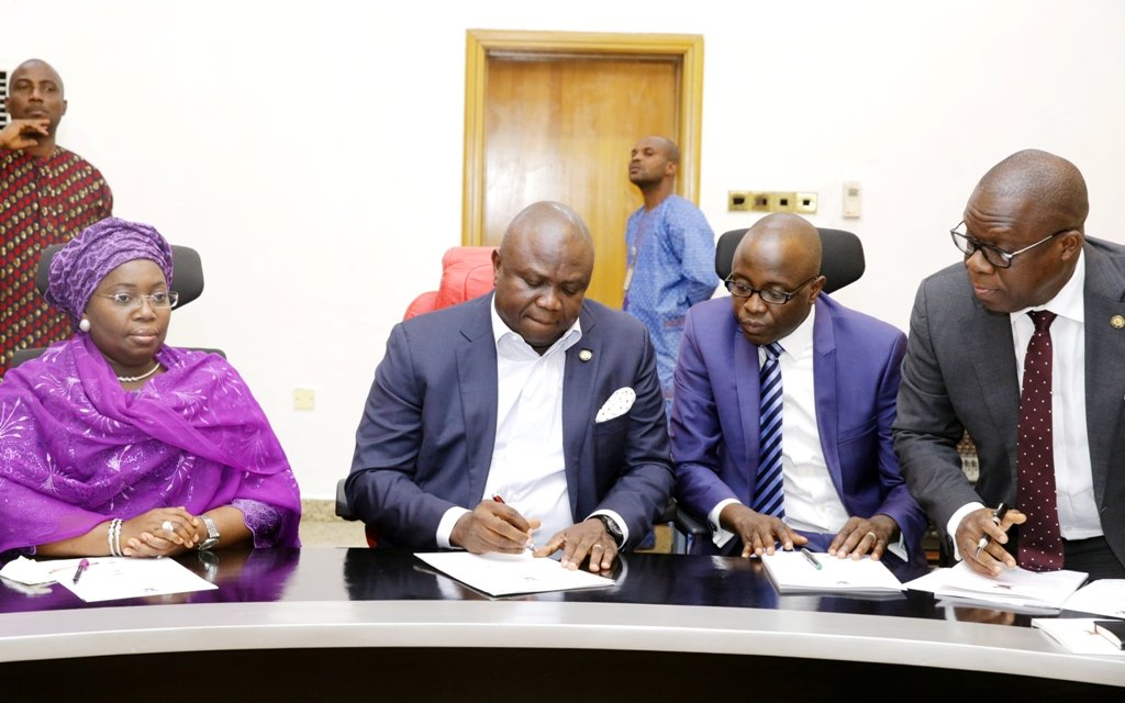 Lagos State Governor Akinwunmi Ambode (2nd left); Deputy Governor, Mrs. Oluranti Adebule (left); Commissioner for Finance/Economic Planning and Budget, Mr. Adeyemi Ashade (2nd right); and Attorney General and Commissioner for Justice, Mr. Adeniji Kazeem during the signing of N47 billion bond deal with issuing houses at the Banquet Hall, Lagos House, Ikeja…yesterday