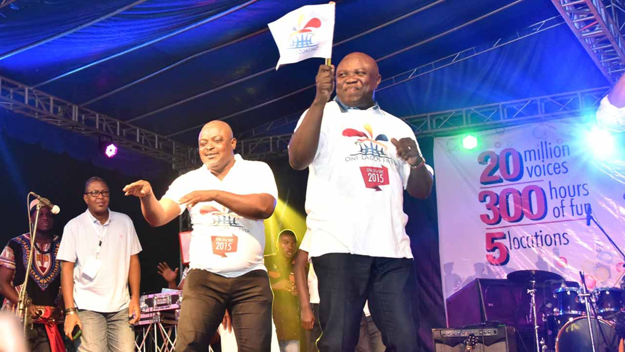 Governor Akinwunmi Ambode with flag dancing with the Speaker, House of Assembly, Mudashiru Obasa at the flag-off of One Lagos Fiesta in Lagos