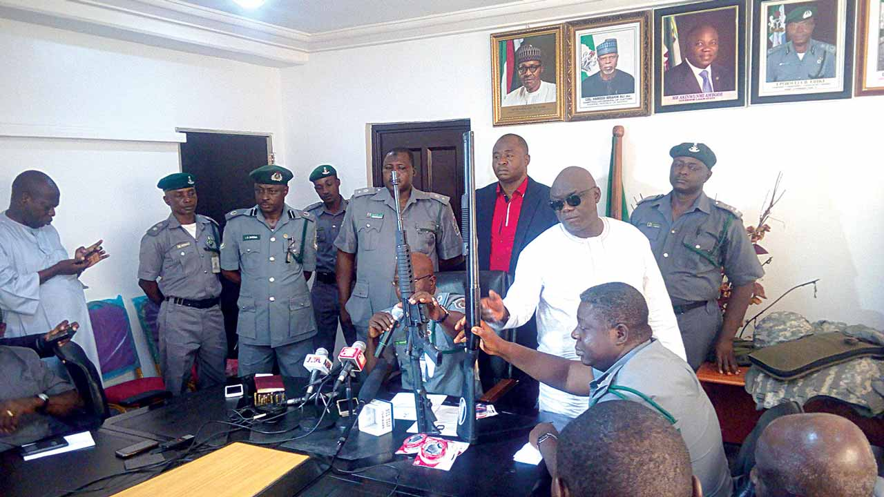 The Controller, Tin Can Island Command, Nigerian Customs Service, Yusuf Bashar, displaying the arms seized from an importer before handover to the Department of State Services in Lagos…