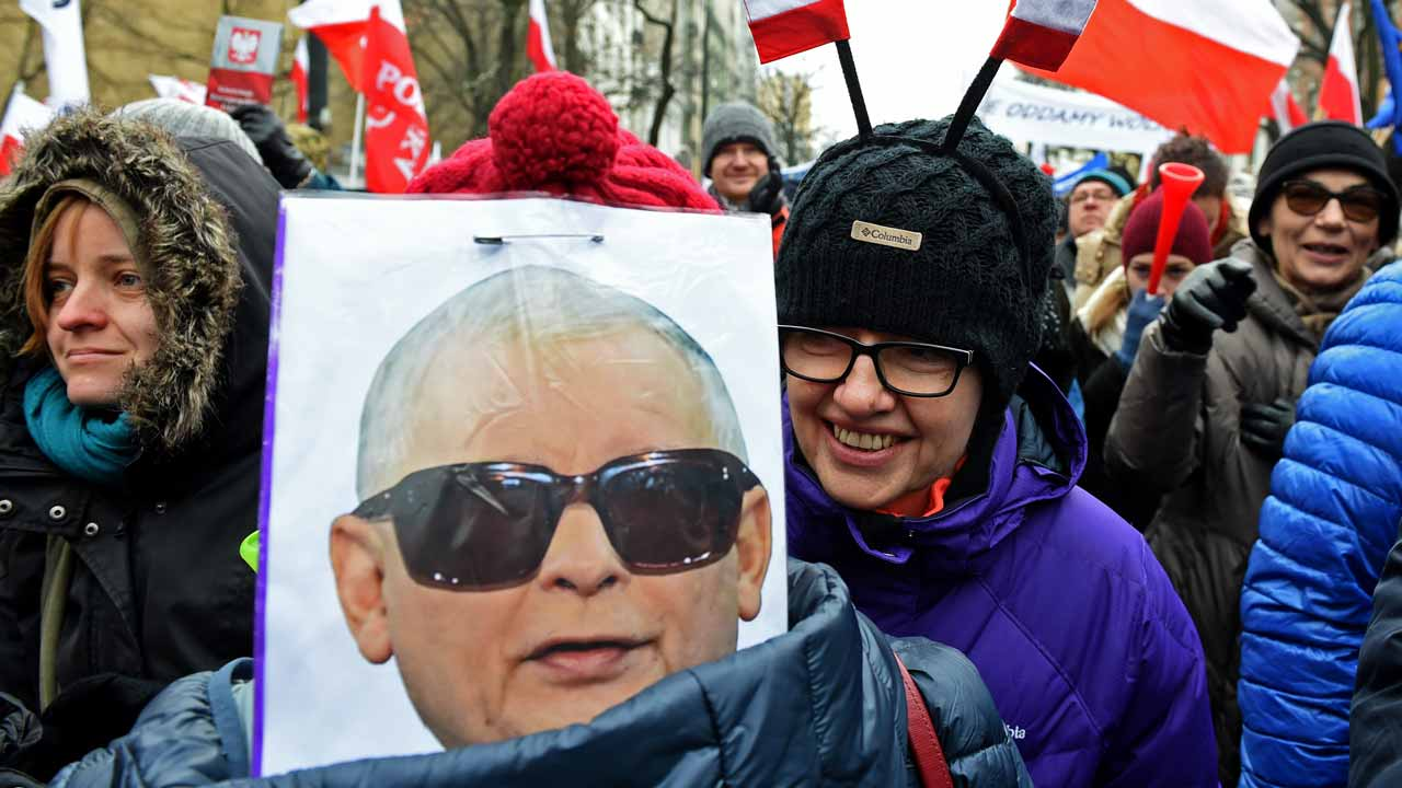 A caricature depicting Jaroslaw Kaczynski, head of leading PIS party as General Wojciech Jaruzelski, who imposed the martial law in Poland in 1981 is seen during an anti-government protest in front of the Constitutional Court to thank the outgoing head of court Andrzej Rzeplinski for his efforts to defend its independence, in Warsaw on December 18, 2016. Polish President Andrzej Duda was holding talks Sunday to try to end a seething political crisis which has seen mass anti-government protests across the country and a parliamentary blockade. Janek SKARZYNSKI / AFP