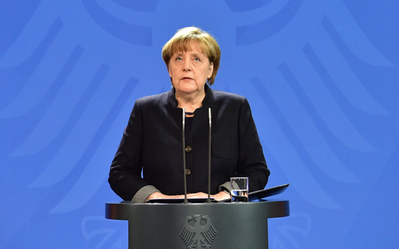 German Chancellor Angela Merkel speaks during a press conference on December 20, 2016 in Berlin following a terrorist attack the killing of 12 people when a speeding lorry cut a bloody swathe through a Berlin Christmas market. / AFP PHOTO / John MACDOUGALL