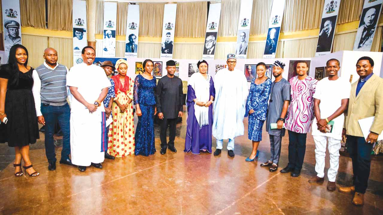 President Muammadu Buhari and his wife, Aisha; Vice President, Prof Yemi Osinbajo and his wife, Dolapo, during the artists' visit to Aso Rock