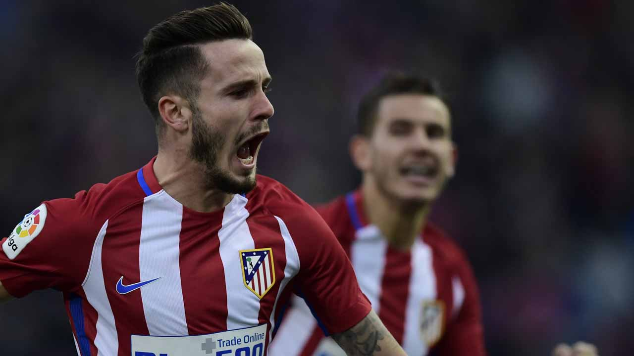 Atletico Madrid's midfielder Saul Niguez celebrates after scoring during the Spanish league football match Club Atletico de Madrid vs UD Las Palmas at the Vicente Calderon stadium in Madrid on December 17, 2016. JAVIER SORIANO / AFP