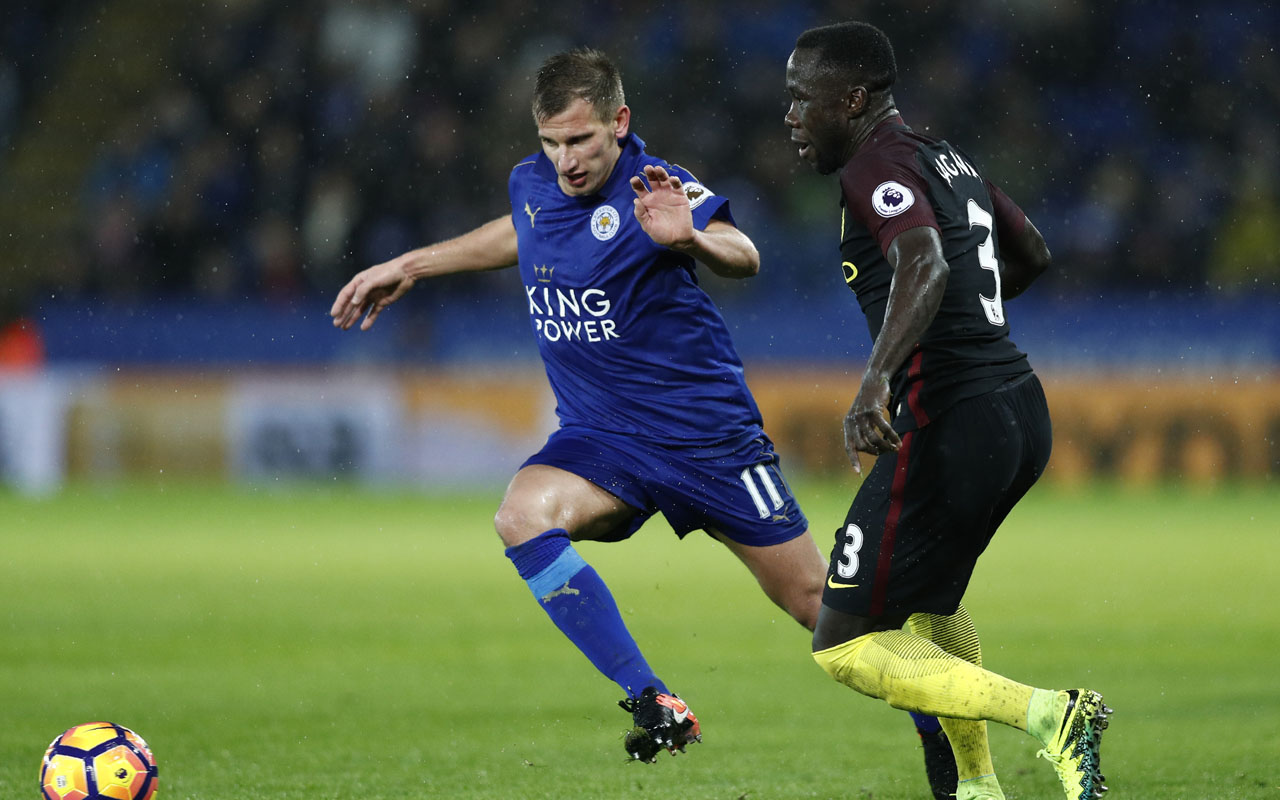 Leicester City's English midfielder Marc Albrighton (L) vies with Manchester City's French defender Bacary Sagna during the English Premier League football match between Leicester City and Manchester City at King Power Stadium in Leicester, central England on December 10, 2016. Leicester won the game 4-2. / AFP PHOTO / Adrian DENNIS /