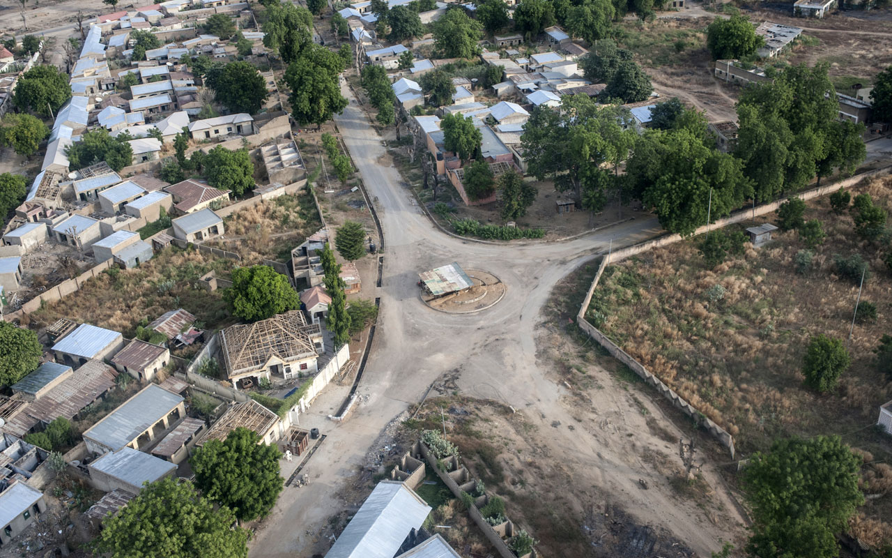 An aerial view taken on December 8, 2016 shows Bama, northeast Nigeria, where reconstruction is underway after the town was liberated from Boko Haram. The conflict with Boko Haram in northeast Nigeria has displaced more than 2.6 million people. Some 1.7 million are now living in camps and host communities in Adamawa, Borno, Gombe and Yobe states, heaping pressure on local authorities and causing humanitarian challenges such as food security, access to clean water and healthcare. Borno has the most IDPs (internally displaced people). / AFP PHOTO / STEFAN HEUNIS