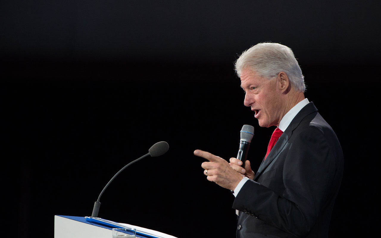 """Former US President and Founding Chairman of the Clinton Global Initiative Bill Clinton speaking at the closing Plenary Session: Imagine All The People at the Clinton Global Initiative in New York. President-elect Donald Trump took on Bill Clinton on December 20, 2016 in a new tweet attack, after the former president questioned his intelligence.In an impromptu discussion at a book store in upstate New York earlier this month, Clinton said this when asked if he thought Trump was smart: """"He doesn't know much. One thing he does know is how to get angry, white men to vote for him.""""Clinton made the remarks December 10, and they were reported by a local newspaper editor who happened to be present. The comments were published December 19, 2016 by Politico. / AFP PHOTO / Bryan R. Smith"""