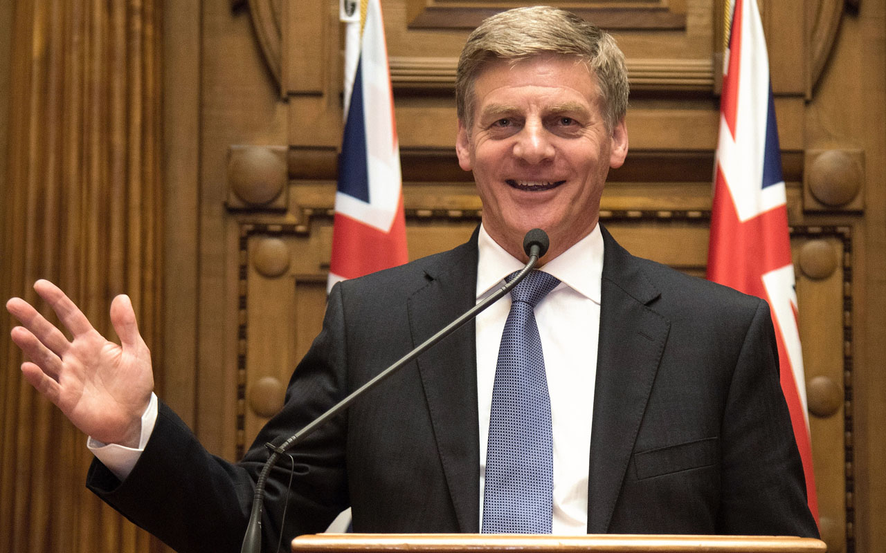 New Zealand's Prime Minister Bill English speaks to the media during a press conference at Parliament in Wellington on December 12, 2016. New Zealand's socially conservative finance chief English was sworn in as the country's new prime minister on December 12 following last week's shock resignation of his popular predecessor John Key. / AFP PHOTO / Marty MELVILLE