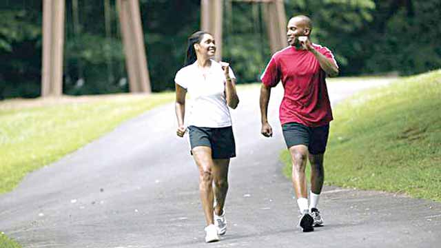 Brisk walk...new research suggests that going for a walk three times a week could help men boost fertility PHOTO CREDIT: http://seattlewatching.com/tag/brisk-walking