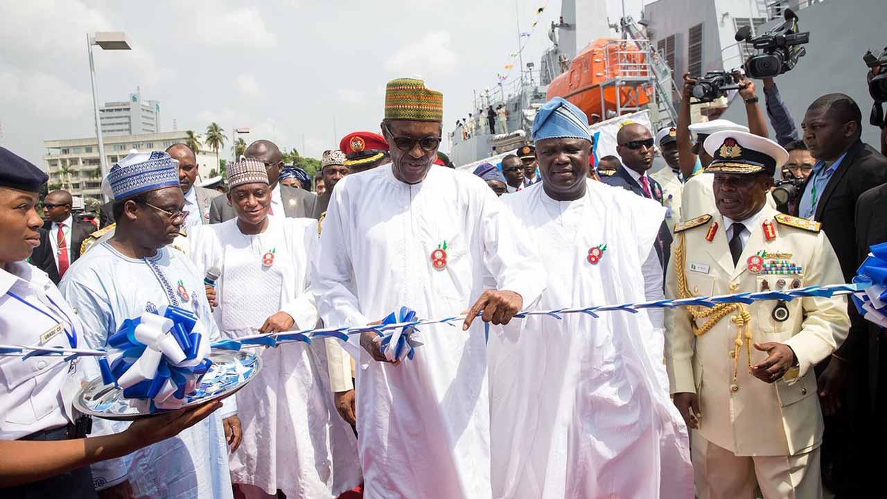 From left, Minister of Defence, Mansur Dan Ali, President Muhammadu Buhari and Akinwumi Ambode of Lagos State, while inaugurating Nigerian Navy Ship in Lagos on Thursday, December 15, 2016.