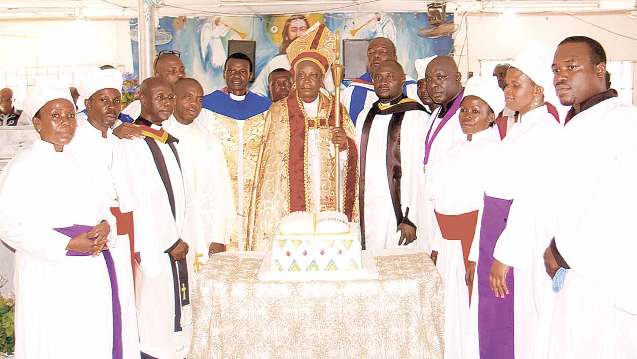 Bishop, Lagos West Diocese, Christ Army Church of Nigeria, His Lordship, Rev. Japhet Iheanyi Oparah (centre) flanked by Canon Effiong (right); Venerable Ehimatie; Rev. Bonafide Ofeh; Rev-Canon Chuks Ndubuisi; Rev. C. Chima; Prophet Emmanuel Nwadike; Prophetess Regina Adeosun; Venerable Uche Oparah (JP) (left); Rev. Emma Peters; Prophet Omaka; Catechist Ibe Ifeanyi; Prophetess Gloria Ajayi; Prophetess Patience Ugwoke and Catechist Chijioke Amako, during the ordination and licensing of priests in Lagos.