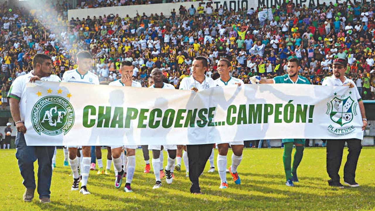 Officials and fans of Chapecoense carrying a banner confirming the Brazilian club as Copa Sudamerica champions. PHOTO: FOURFOURTWO.