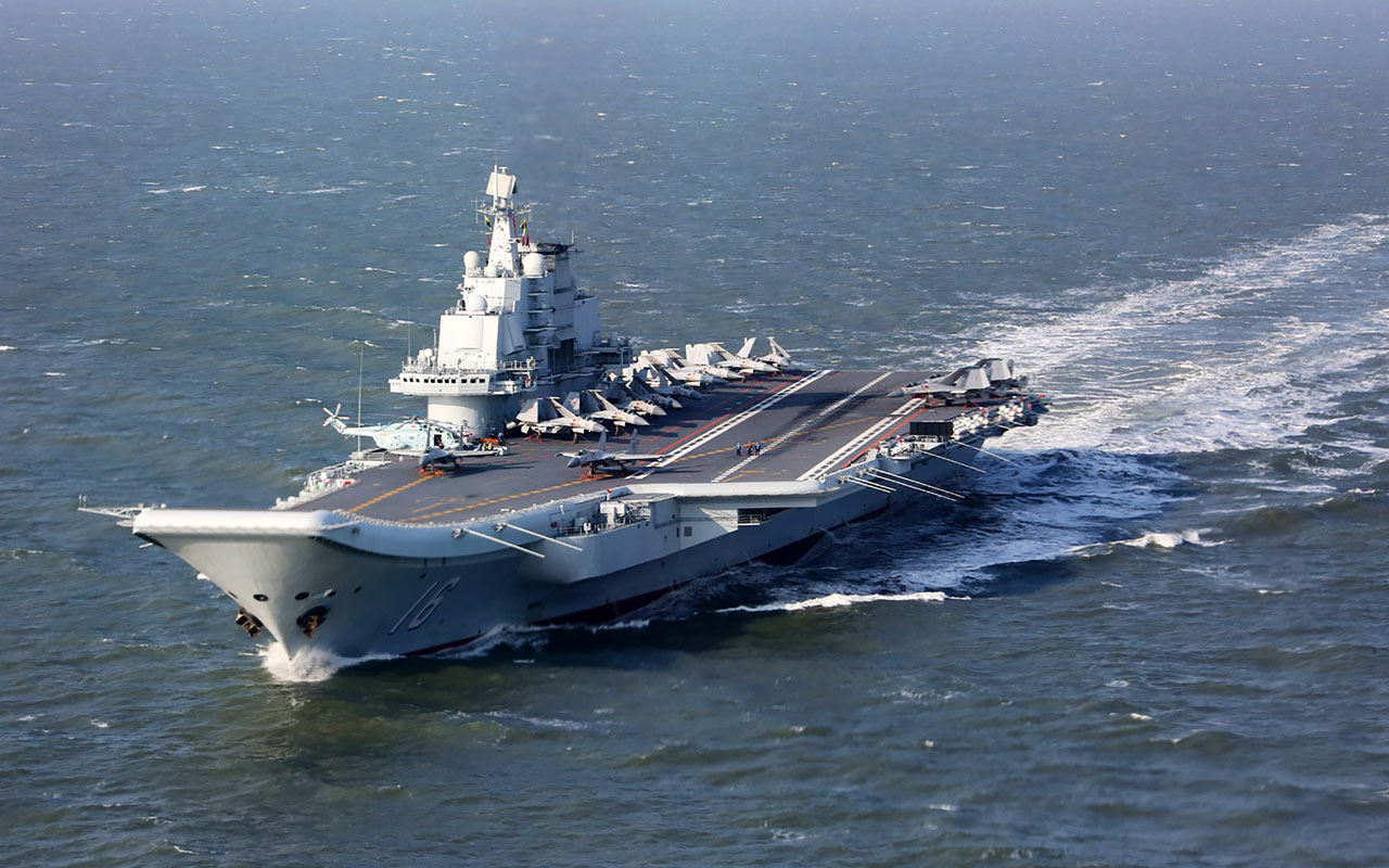This photo taken on December 24, 2016 shows the Liaoning, China's only aircraft carrier, sailing during military drills in the Pacific. Taiwan's defence minister warned on December 27 that enemy threats were growing daily after China's aircraft carrier and a flotilla of other warships passed south of the island in an exercise as tensions rise. / AFP PHOTO / STR / China OUT