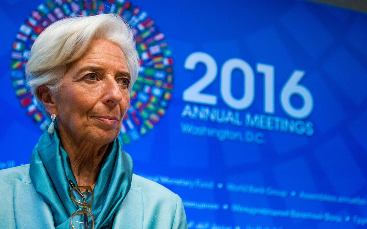 "IMF Managing Director Christine Lagarde speaking during an IMFC press conference at the 2016 Annual Meetings of the International Monetary Fund and the World Bank Group at the IMF Headquarters on October 8, 2016 in Washington, DC. IMF chief Christine Lagarde will goe on trial in France on December 12, 2016 over a massive state payout to a flamboyant tycoon when she was finance minister in a case that risks tarnishing her stellar career. Lagarde denies the charges of negligence, arguing she was acting ""in the state's interest"" in making the payment to Bernard Tapie, the former owner of sportswear giant Adidas and Olympique Marseille football club. If found guilty, Lagarde could receive a one-year prison sentence and a 15,000 euro ($15,900) fine. / AFP PHOTO / ZACH GIBSON"