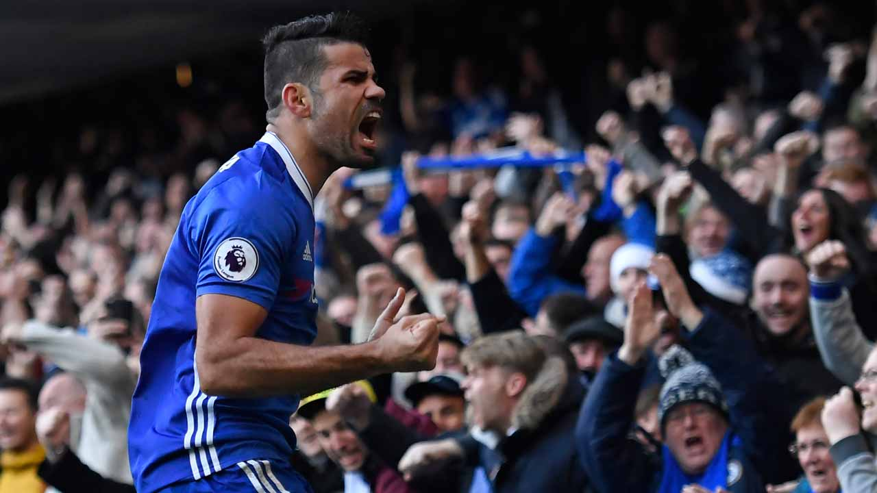 Chelsea's Brazilian-born Spanish striker Diego Costa celebrates after scoring the opening goal of the English Premier League football match between Chelsea and West Bromwich Albion at Stamford Bridge in London on December 11, 2016. Justin TALLIS / AFP
