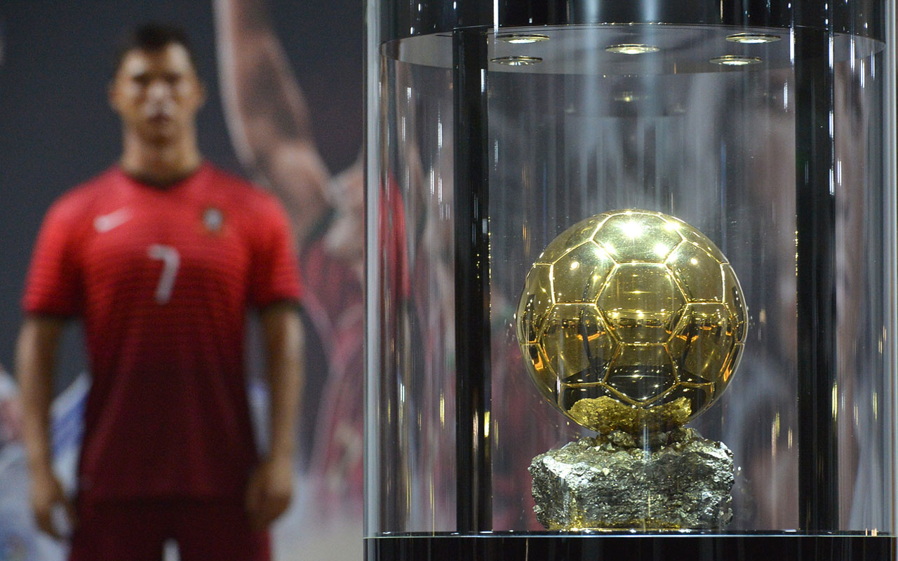 a wax statue representing Portugese forward Cristiano Ronaldo and a FIFA Ballon d'Or displayed at the new location of the CR7 museum dedicated to Ronaldo's professional career at Funchal, on the Portuguese island of Madeira on July 23, 2016. / AFP PHOTO / JOANA SOUSA
