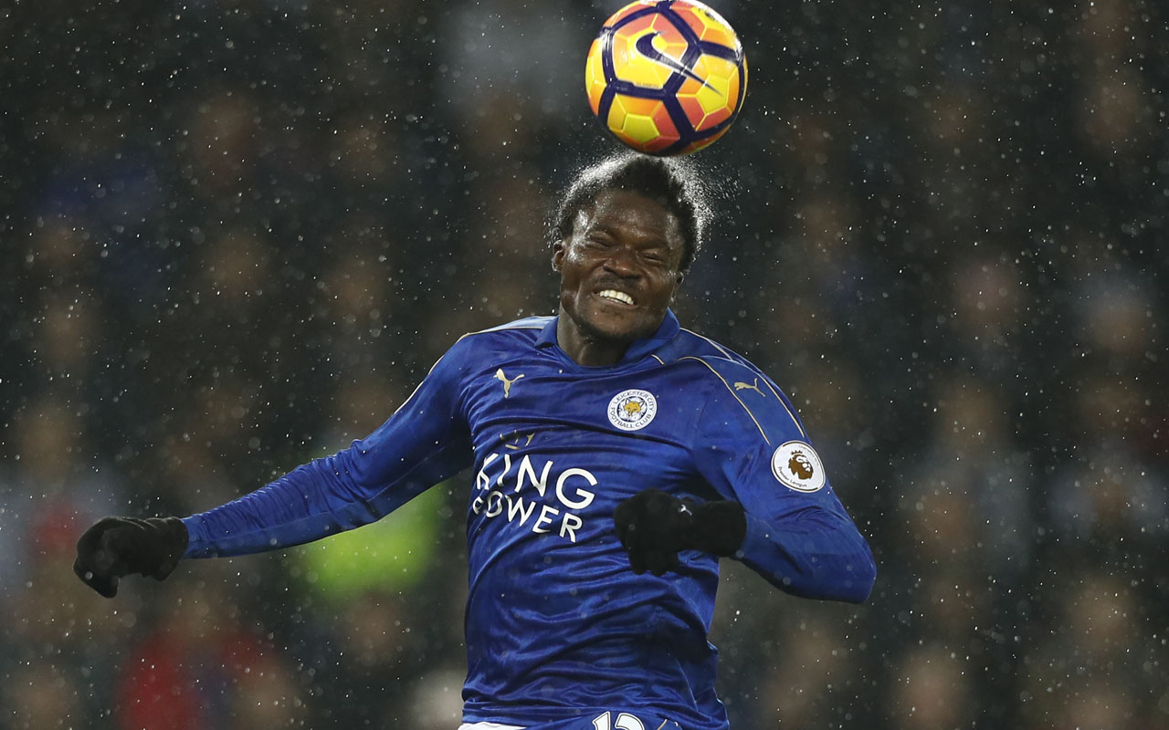 Leicester City's Ghanaian midfielder Daniel Amartey heads the ball during the English Premier League football match between Leicester City and Manchester City at King Power Stadium in Leicester, central England on December 10, 2016. / AFP PHOTO / Adrian DENNIS /