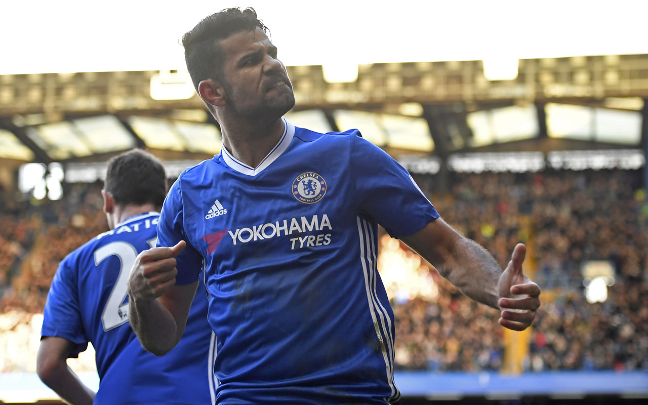 Chelsea's Brazilian-born Spanish striker Diego Costa celebrates after scoring the opening goal of the English Premier League football match between Chelsea and West Bromwich Albion at Stamford Bridge in London on December 11, 2016. / AFP PHOTO / Justin TALLIS /