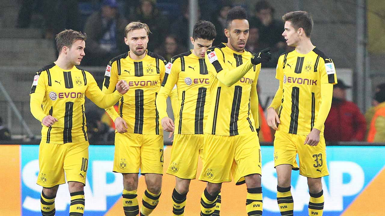 4Dortmund's Gabonese forward Pierre-Emerick Aubameyang (2nd R) celebrates scoring the 2-2 with his team-mates vie for the ball during the German first division Bundesliga football match between TSG Hoffenheim and BVB Borussia Dortmund at the Wirsol Rhein-Neckar-Arena in Sinsheim, southern Germany, on December 16, 2016. Daniel ROLAND / AFP