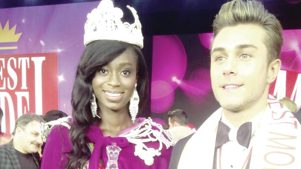 Nigeria's Ejiro with winner Best Model World (male) at the event in Turkey.