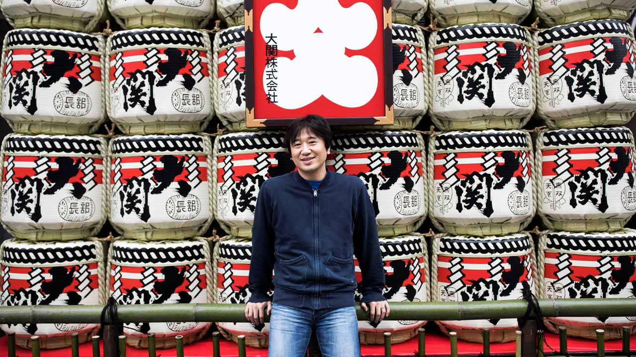 "Japanese Shigetaka Kurita, the man who created emoji charachters, poses for a portrait in Tokyo on November 30, 2016. Kurita was working at major telecom NTT Docomo in 1999 when he sketched out one of the first emoji, a clunky looking thing barely recognisable as the precursor to today's yellow smiley face. From a humble smiley face with a box mouth and inverted ""V's"" for eyes, crude weather symbols, and a rudimentary heart -- emoji have now exploded into the world's fastest-growing language. Behrouz MEHRI / AFP"
