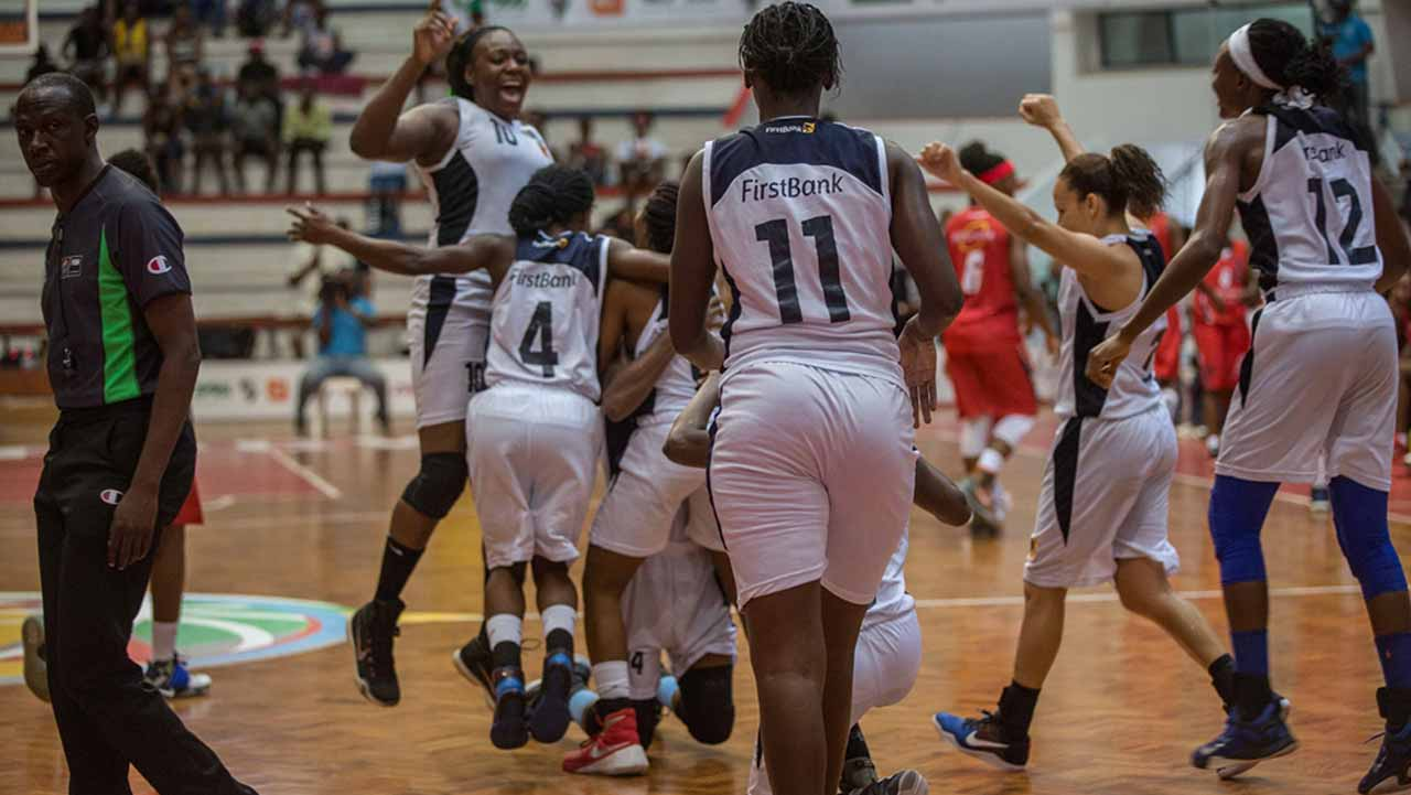 First Bank players celebrating their bronze medal after beating Primiero Agosto in the third place game at the FIBA Africa Women Champions Cup.
