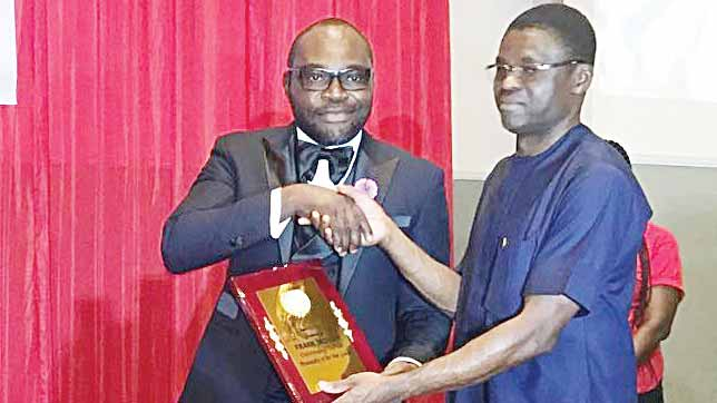 Edo State Deputy Governor, Philip Shaibu (right), presenting the Outstanding Football Personality of the Year award to FROT Group Chairman, Frank Momoh, during the just-concluded Edo FA Awards.