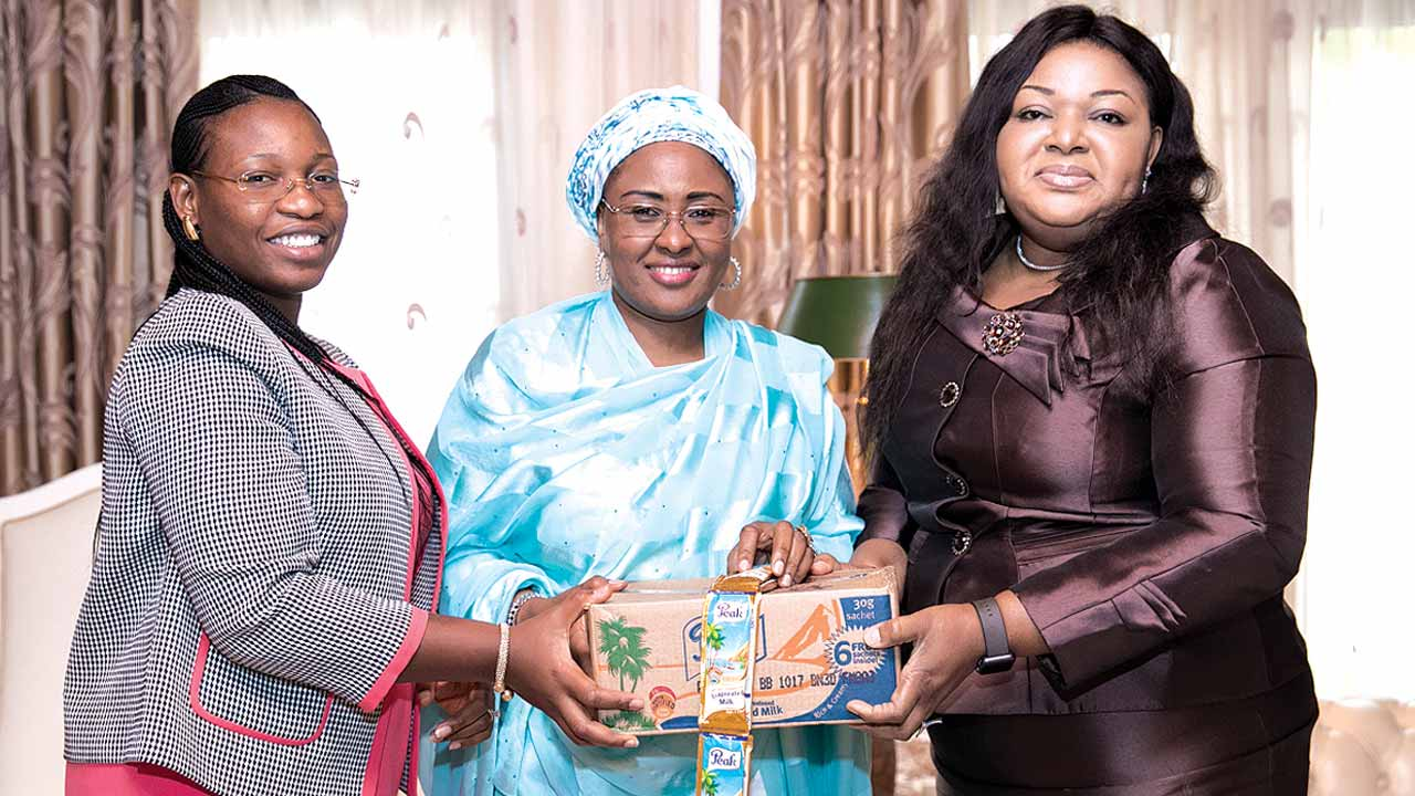 Nigeria's First Lady, Mrs. Aisha Buhari (middle) receiving Corporate Affairs Director, FrieslandCampina WAMCO, Mrs. Ore Famurewa (right) and Public Affairs Manager, Mrs. Temitope Adeola (left) in Aso Rock for the company's support of her 'Get Involved' campaign with a donation of 5000 cartons of Peak Milk sachets for internally displaced persons (IDPs) in northeast Nigeria.