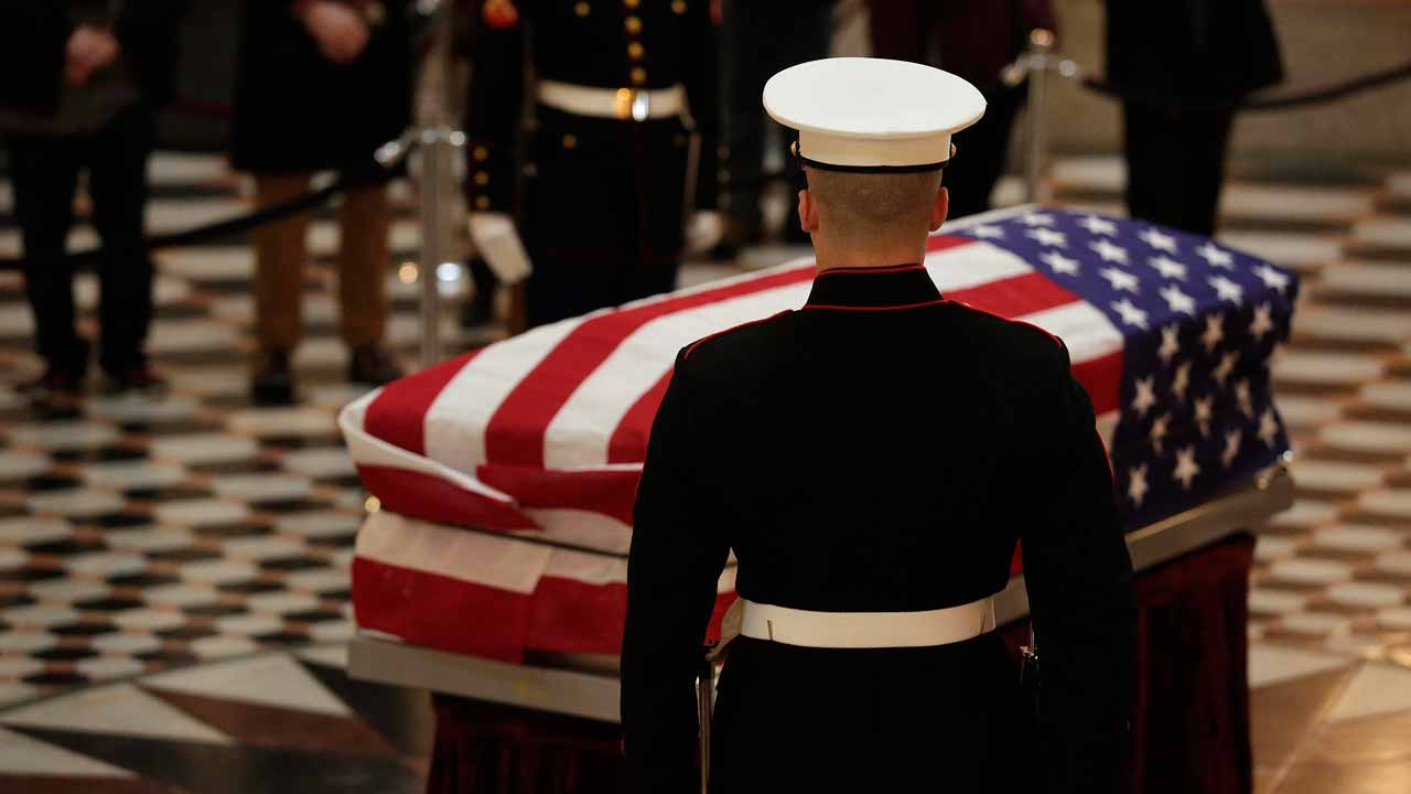 United States Marines stand guard as they surround the casket of former Astronaut and US Senator John Glenn, as he lays in state at the Ohio Statehouse on December 16, 2016 in Columbus, Ohio. Glenn died on December 8, 2016 at the age of 95.  Joshua Lott / AFP