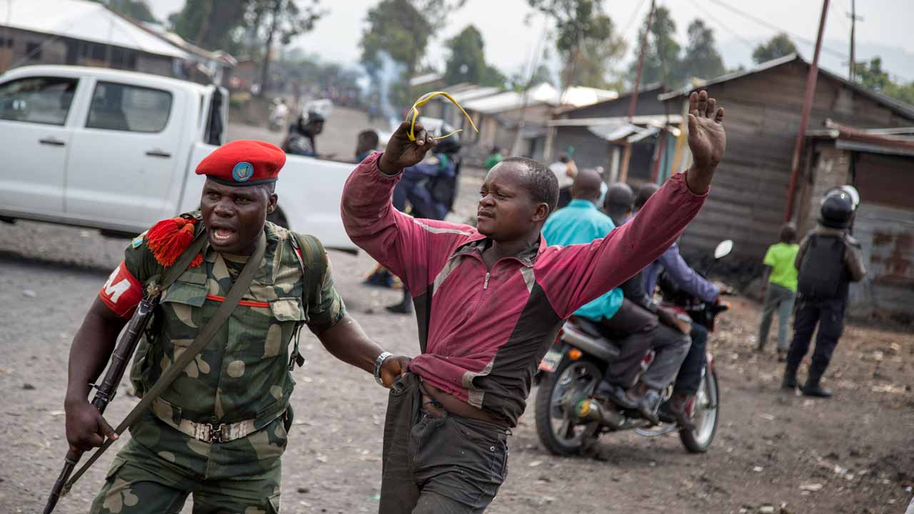 A man is arrested by a member of the military police after people attempted to block the road with rocks, in the neighbourhood of Majengo in Goma, eastern Democratic Republic of the Congo, on 19 December, 2016, as tensions rose with one day left of Congolese President's mandate. Joseph Kabila's second term ends on December 20 but he has shown no sign of stepping down and mediation talks have failed, sparking fears of fresh political violence in the mineral-rich but unstable Democratic Republic of Congo. Griff Tapper / AFP