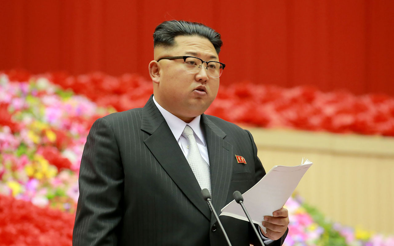 This photo taken on December 23, 2016 and released on December 24 by North Korea's official Korean Central News Agency (KCNA) shows North Korean leader Kim Jong-Un making an opening address at the First Conference of Chairpersons of the Primary Committees of the Workers' Party of Korea at the Pyongyang Indoor Stadium in Pyongyang. / AFP PHOTO / KCNA / STR / South Korea OUT / REPUBLIC OF KOREA OUT