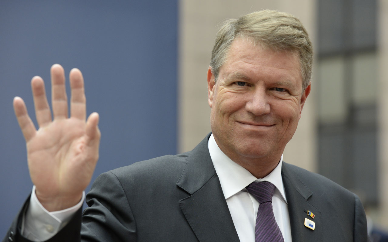 (FILES) In this file photo taken on October 20, 2016, Romania's President Klaus Werner Iohannis gestures as he arrives for an European Union leaders summit at the European Council, in Brussels. Romania's president rejected on December 27, 2016 the left-wing Social Democrats' candidate for prime minister, Sevil Shhaideh, who would have been the EU's country first female and Muslim premier./ AFP PHOTO / THIERRY CHARLIER