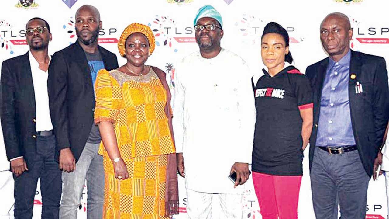 Lagos State Commissioner for Information, Steve Ayorinde (third from right); dancer Kafayat Shafau (Kaffy) with other members of The Lagos Street Party organising committee.