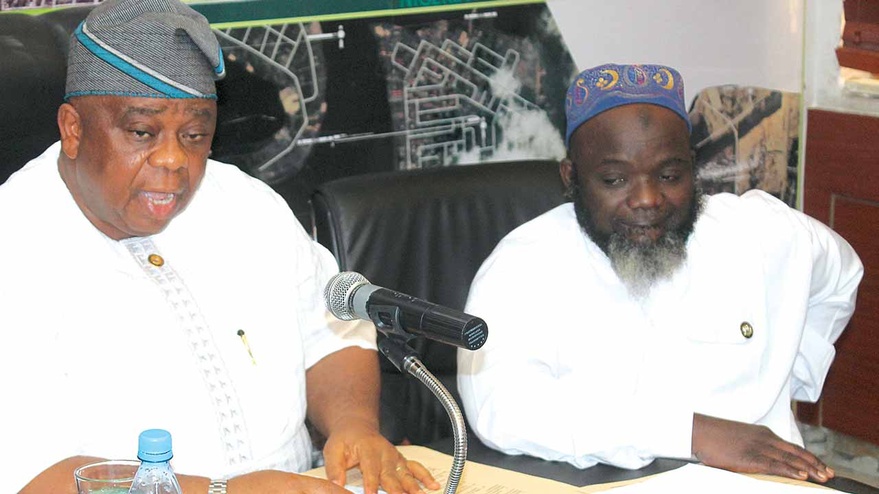 Commissioner for the Environment, Dr. Babatunde Adejare (left) and the Permanent Secretary in the Ministry, Adeyemi Saliu at the December 2016 monthly briefing