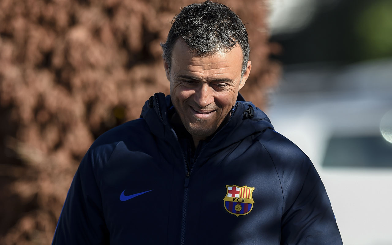 Barcelona's coach Luis Enrique walks to press conference at the Sports Center FC Barcelona Joan Gamper in Sant Joan Despi, near Barcelona on December 2, 2016 on the eve of their Spanish League Clasico football match FC Barcelona vs Real Madrid. / AFP PHOTO / JOSEP LAGO