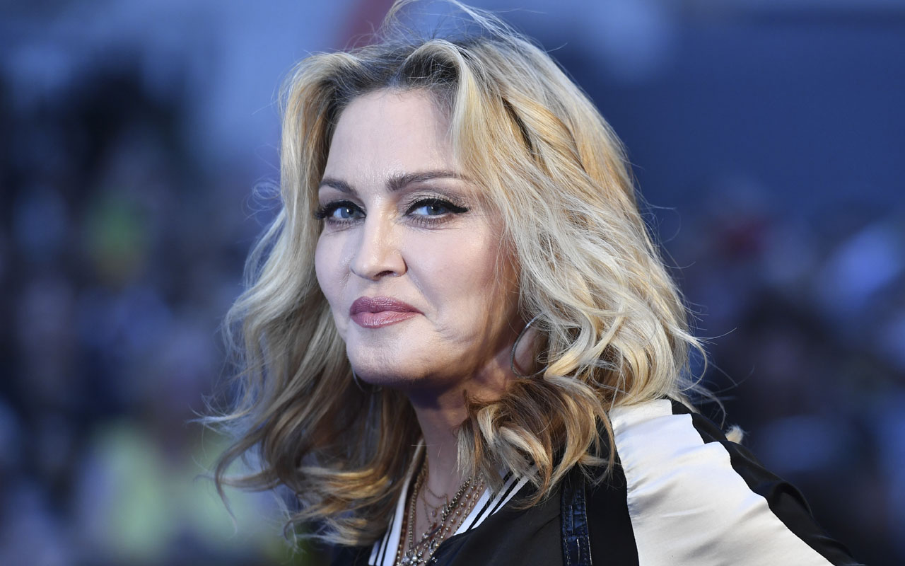 "US singer-songwriter Madonna poses arriving on the carpet to attend a special screening of the film ""The Beatles Eight Days A Week: The Touring Years"" in London. Madonna is voicing despair over Donald Trump's election victory and blamed women, saying they had a ""tribal inability"" to accept a female president. The election ""felt like a combination of the heartbreak and betrayal you feel when someone you love more than anything leaves you, and also a death,"" the pop icon told Billboard magazine in an interview published December 5, 2016. / AFP PHOTO / Ben STANSALL"