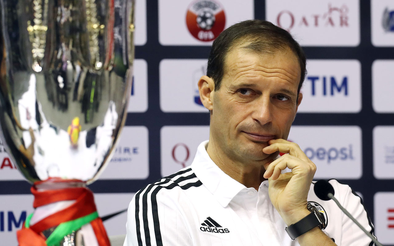 Juventus' Italian head coach Massimiliano Allegri attends a press conference in the Qatari capital Doha on December 22, 2016, on the eve of the Final of the Italian Super Cup between AC Milan and Juventus. / AFP PHOTO / KARIM JAAFAR