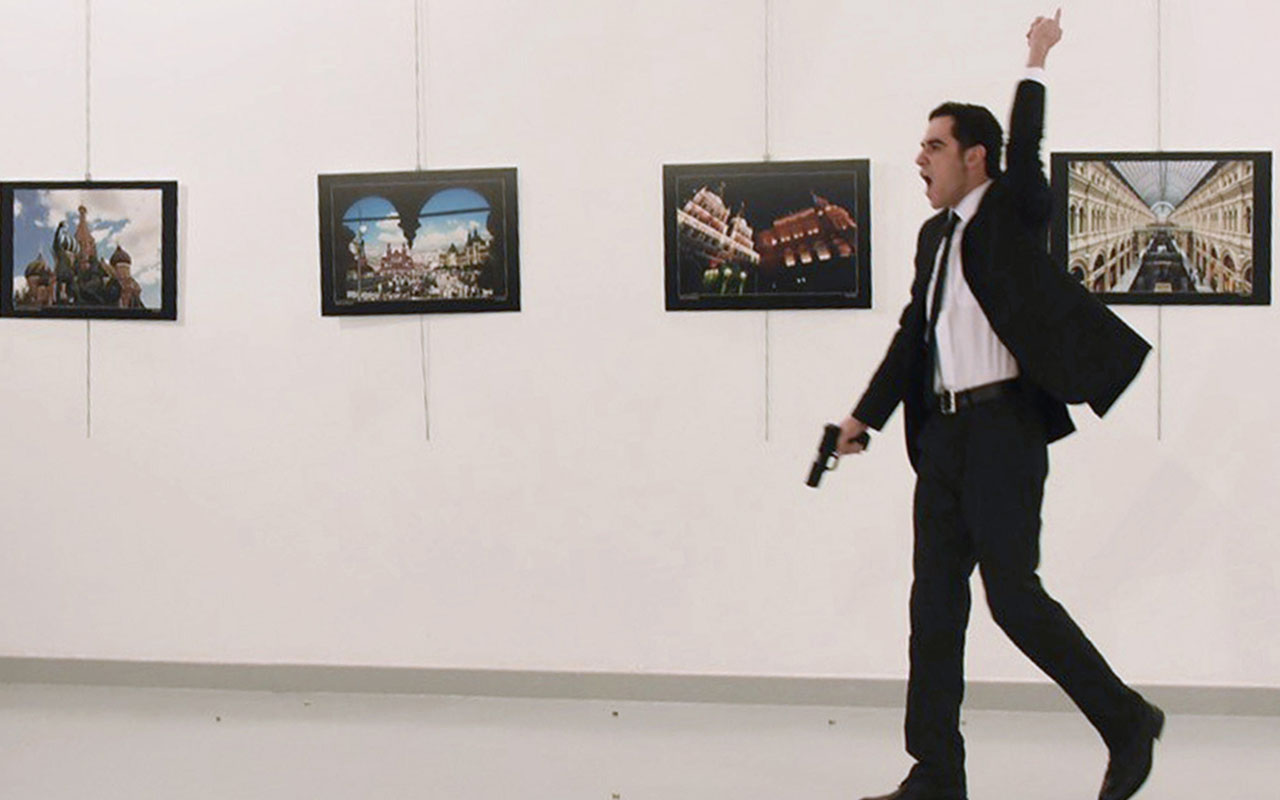 "Mevlut Mert Altintas, the gunman who killed Russia's Ambassador to Turkey, during an attack during a public event in Ankara. A gunman crying ""Aleppo"" and ""revenge"" shot Karlov while he was visiting an art exhibition in Ankara on December 19, witnesses and media reports said. The Turkish state-run Anadolu news agency said the gunman had been ""neutralised"" in a police operation, without giving further details. / AFP PHOTO / Sozcu daily / Yavuz Alatan"