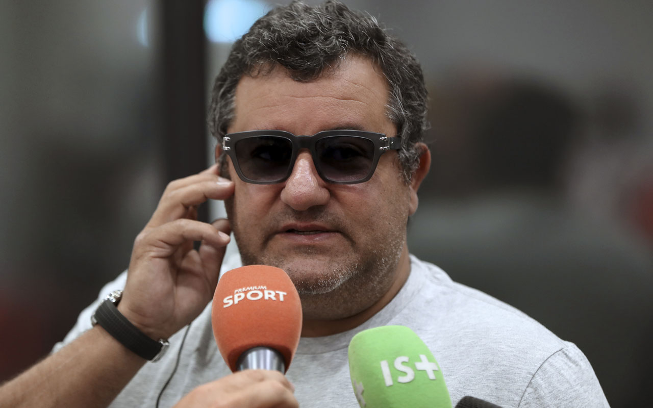 Italian-born Dutch football agent Mino Raiola speaking to journalists during presentation of Nice's football club new signings at the Allianz Riviera stadium in Nice, southeastern France. / AFP PHOTO / VALERY HACHE