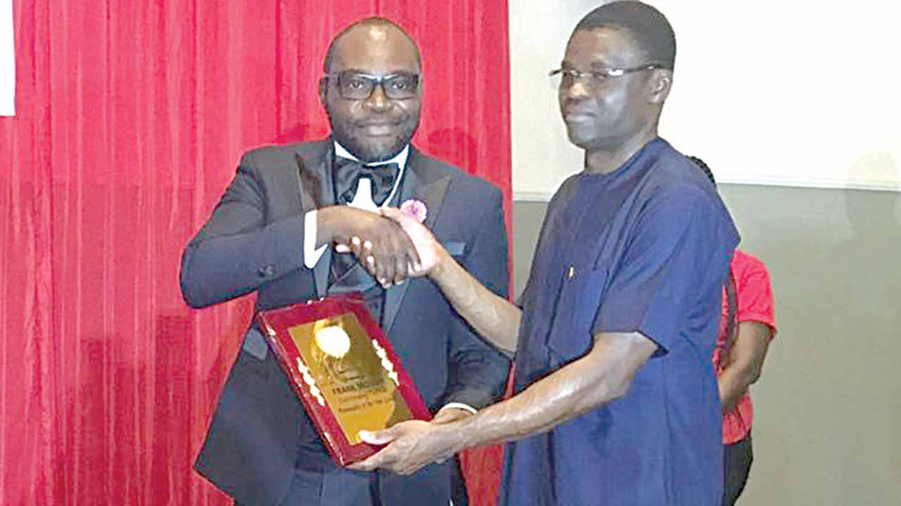 Edo State Deputy Governor, Tony Shaibu, presenting the Outstanding Football Personality of the Year Award to FROT Group Chairman, Tony Momoh, during the Edo FA Awards in Benin…at the weekend.
