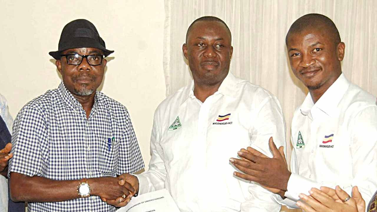 The National President of NAMB,Valentine Whensu (left),the Executive Director Technical NICON Insurance Ltd, Akinsola Ale, and the Chief Marketing Officer of NICON,Samson Davies, at the signing of the MOU between NICON and NAMB in Uyo, Akwa Ibom state.