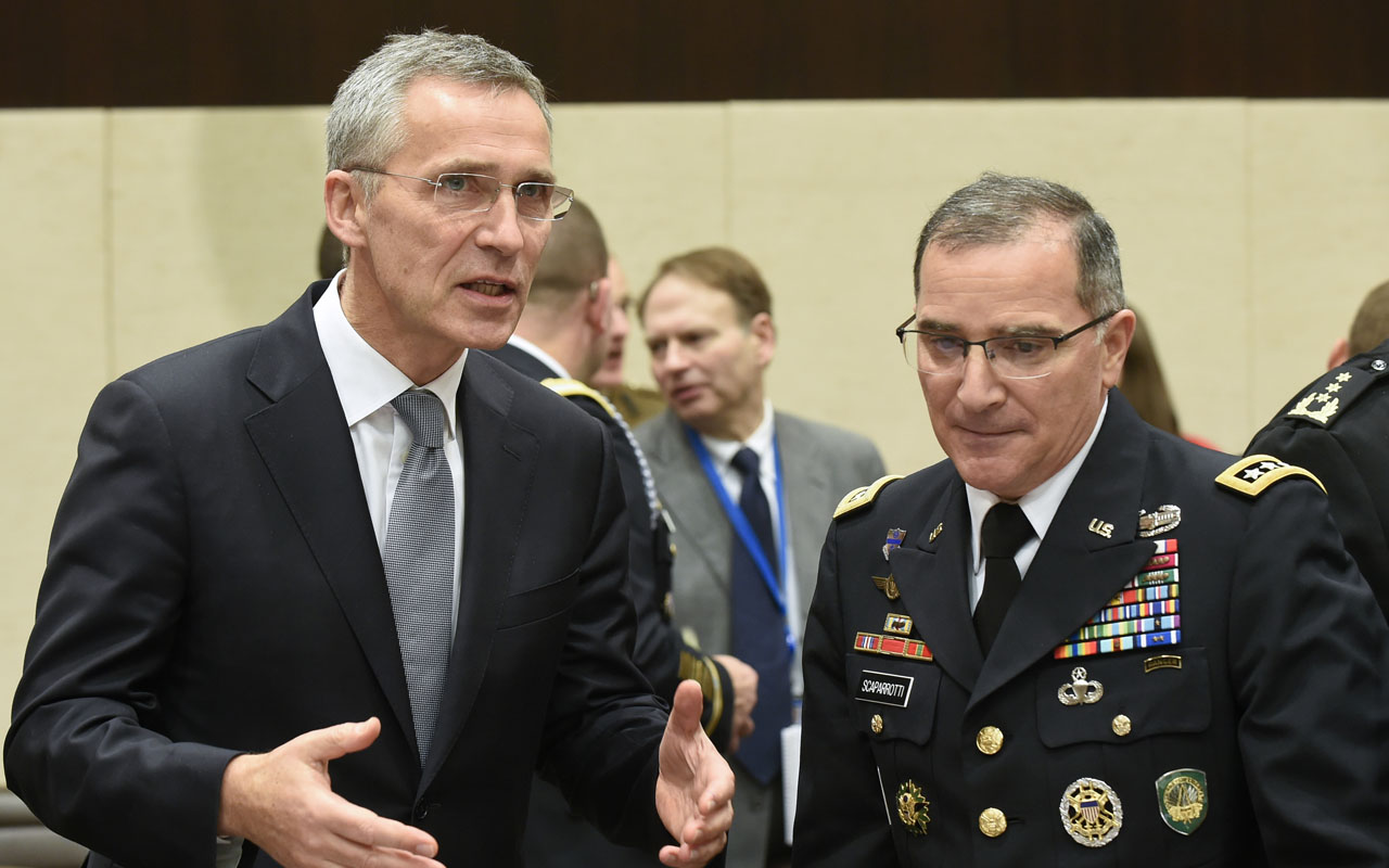 NATO Secretary-General Jens Stoltenberg (L) talks with Supreme Allied Commander Europe of NATO Allied Command Operations Curtis M. Scaparrotti (R) during a Foreign Affairs meeting at the NATO headquarters in Brussels on December 7, 2016. / AFP PHOTO / JOHN THYS