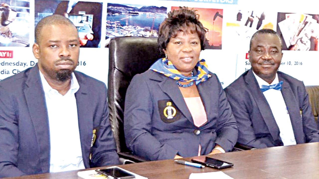 General Secretary, Nigerian Institute of Quantity Surveyors (NIQS), Lagos Chapter, Mr. Ayodele Alao (left); Chairman, Mrs. Adenike Ayanda and Deputy Chairman, Mr. Bamidele Mafimidiwo during a Media Chat with the NIQS executives.