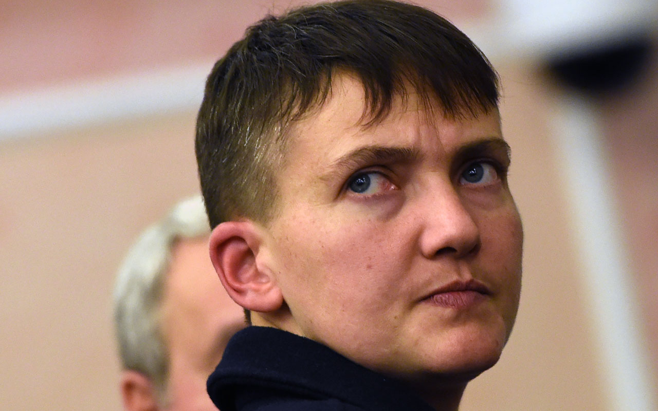Ukrainian pilot and deputy of the country's parliament Nadiya Savchenko looking on as she walks inside Russia's Supreme Court building in Moscow after attending an appeal against Moscow's sentencing of Ukrainians Stanislav Klykh and Mykola Karpyuk, who were slapped with up to 22 years in prison for fighting in the 1990s Chechnya war. A popular Ukrainian female combat pilot who served time in a Russian prison gave President Petro Poroshenko a new headache on December 27, 2016 by launching her own opposition movement. Savchenko's new movement is called RUNA -- an acronym for the Movement of Ukraine's Active People. She said the movement would be transformed into a political party when the time was right. / AFP PHOTO / Vasily MAXIMOV