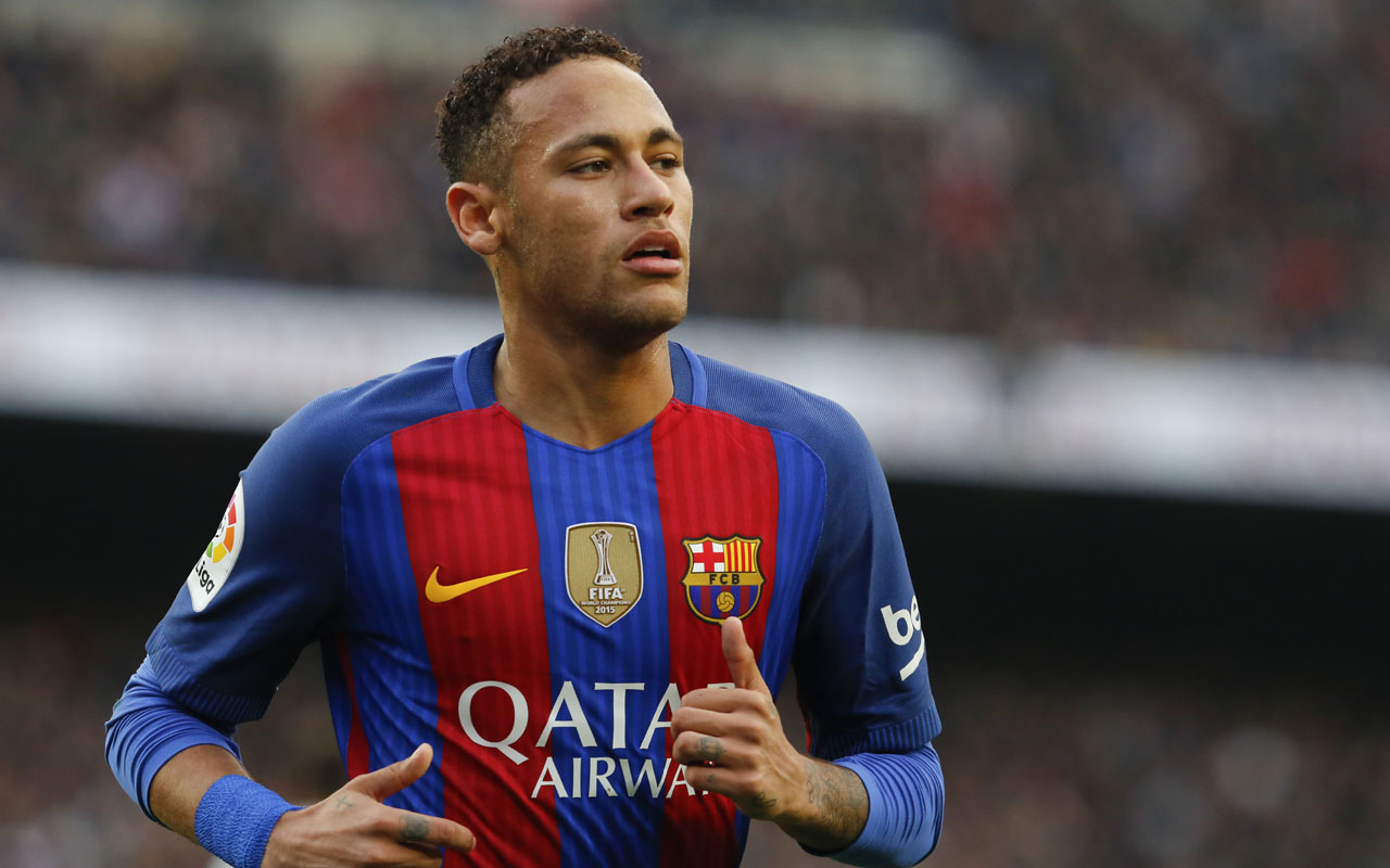 Barcelona's Brazilian forward Neymar runs on the pitch during the Spanish league football match FC Barcelona vs Real Madrid CF at the Camp Nou stadium in Barcelona on December 3, 2016. / AFP PHOTO / PAU BARRENA
