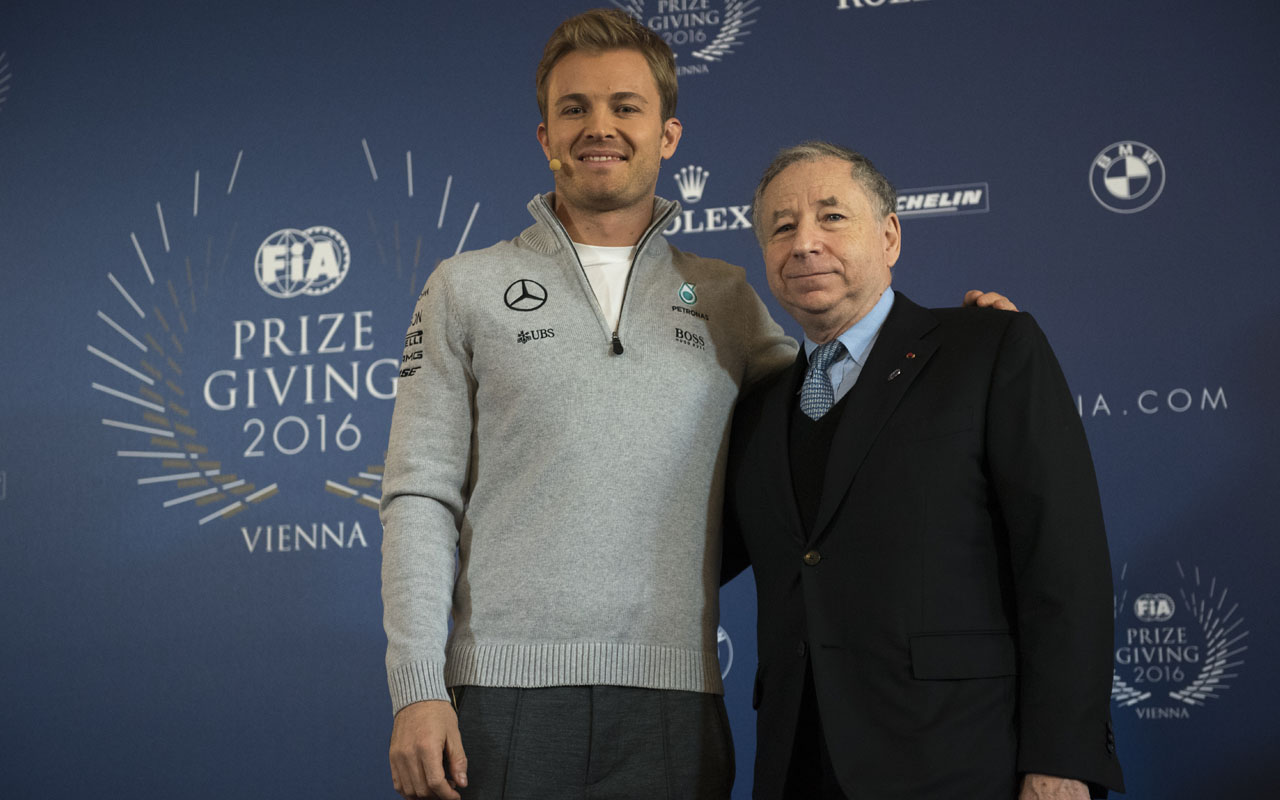F1 World Champion Germany's Nico Rosberg and FIA president Jean Todt during a press conference during FIA Prize Giving Gala at Hofburg palace in Vienna, Austria on December 2, 2016.  / AFP PHOTO / JOE KLAMAR