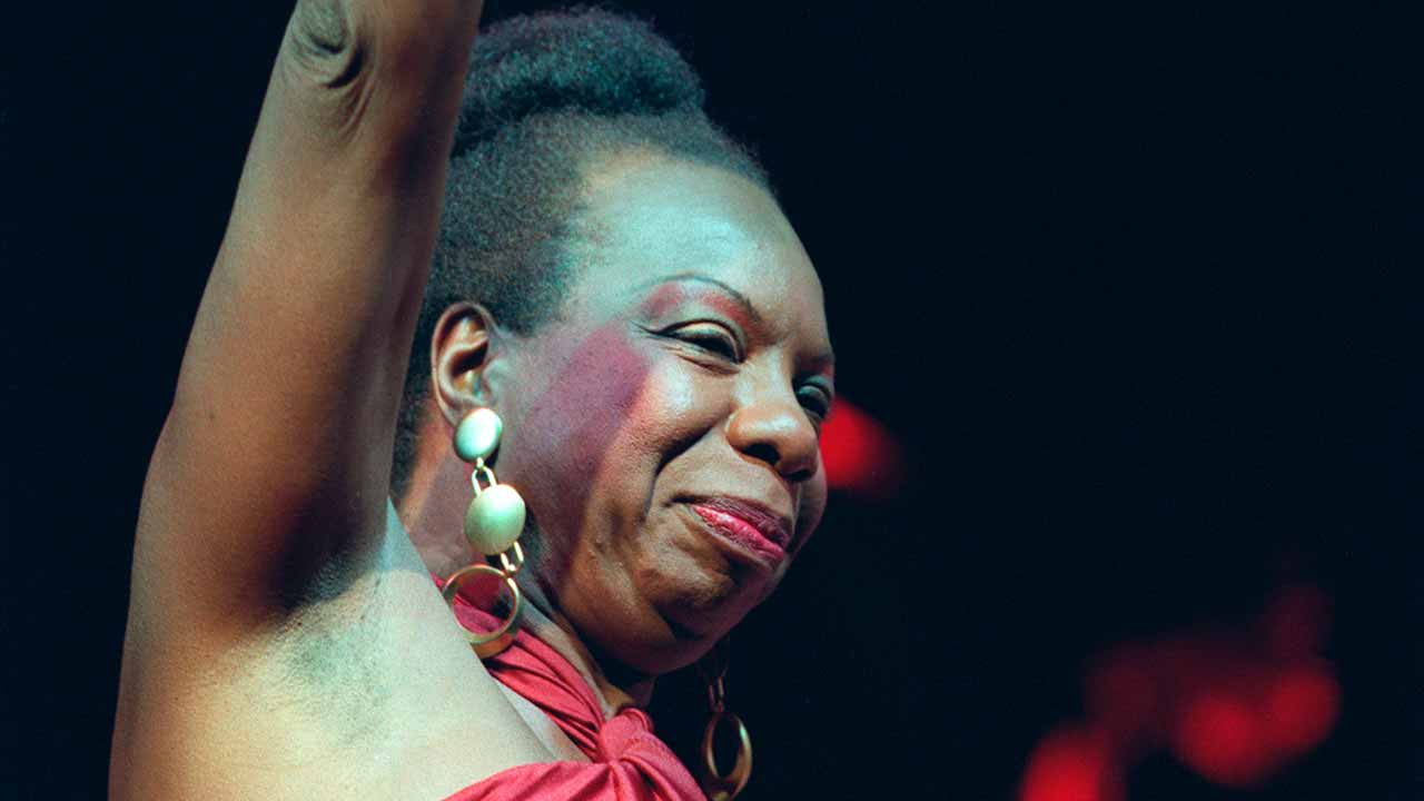 This file photo taken on October 22, 1991 shows legendary jazz and blues singer Nina Simone in concert at the Olympia music hall in Paris. Legendary singer Nina Simone, art-rock pioneers The Velvet Underground and funk great Sly Stone will receive Grammy Lifetime Achievement Awards in 2017, the Recording Academy announced on December 19, 2016. The music industry body each year presents the special prizes for career-spanning influence, in addition to the regular Grammys which recognize the past year's works. Simone -- who never received a Grammy during her lifetime -- was a young piano prodigy who, as an African American in the segregated US South, was discouraged from classical music. BERTRAND GUAY / AFP