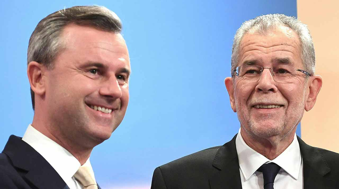 Austrian far-right candidate Norbert Hofer (L) and his rival Alexander Van der Bellen attend a post-selection TV talk with in Vienna on December 4, 2016. Austrian far-right candidate Norbert Hofer on Sunday congratulated his opponent in presidential elections after projections indicated that he had lost. HELMUT FOHRINGER / APA / AFP