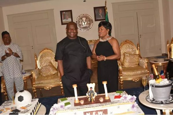 Gov. Nyesom Wike of Rivers (L) and his wife, Justice Eberechi Suzzette Nyesom-Wike cutting the Special birthday cake of the Governor, at the Government House in Port Harcourt on Tuesday (13/1/16). 9063/13/12/2016/Chidi Ohalete/EO/BJO/NAN