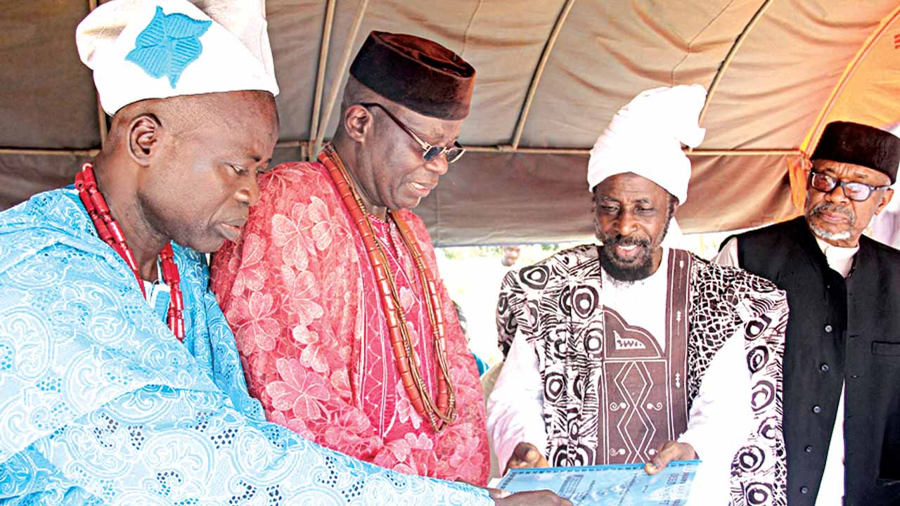 High Chief Ibokun IJesha Osun State, Chief Aro Abdul Fatai Olaiya (left); the Alademure of Ibokun Ijesha, Oba Festus Kayode Awogboro; the Amir, Ahmadiyya Muslim Jama'at Nigeria, Dr Mashhud Adenrele Fashola; and Naib Amir, Special Duties, Engr. Alhaji Al-hassan Ahmed, during the inauguration of Ibokun Mosque in Obokun Ijesha