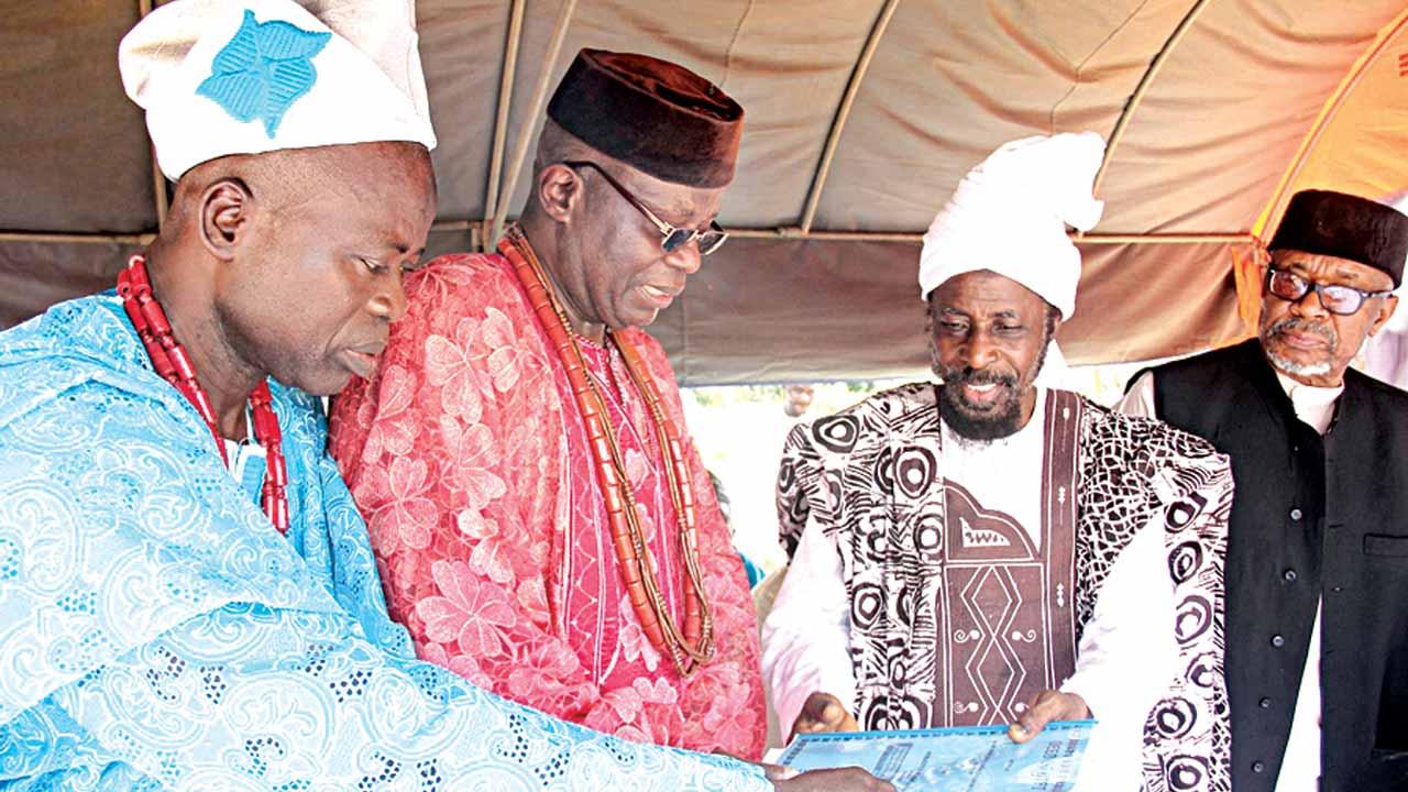 High Chief Ibokun IJesha Osun State, Chief Aro Abdul Fatai Olaiya (left); the Alademure of Ibokun Ijesha, Oba Festus Kayode Awogboro; the Amir, Ahmadiyya Muslim Jama'at Nigeria, Dr Mashhud Adenrele Fashola; and Naib Amir, Special Duties, Engr. Alhaji Al-hassan Ahmed, during the inauguration of Ibokun Mosque in Obokun Ijesha